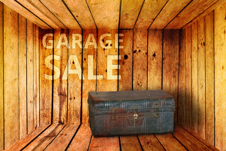 garage on house: old iron box and garage sale words background in wooden room
