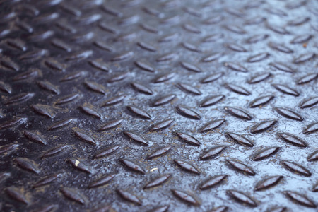 black metallic background: rusted metal texture diamond plate, industry background.