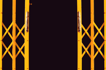 Stock Photo   Yellow Folding Gate, Ancient Yellow Expanded Metal Door On  Black Background