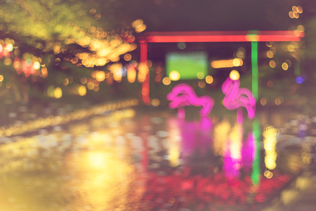 blurred night light background of festival or party with colorful light decoration