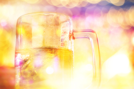 glass of beverage on counter bar in blurred light party bar at night background Banco de Imagens
