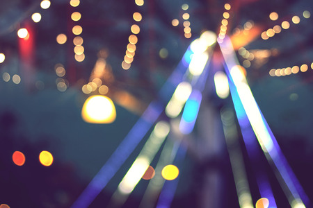 blurred colorful bokeh with glittering shine lights background, light christmas celebration on tree