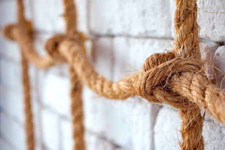 nautical rope decorated on white wall in restaurant