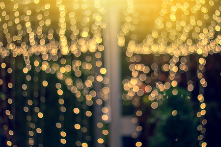 blurred night light with bokeh in festival. christmas abstract light background. Banco de Imagens