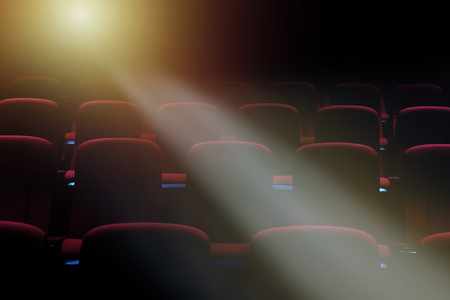 movie theater empty auditorium with red seats and lighting behind