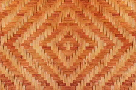 abstract bamboo woven pattern texture for background. detail of wall of country house made of bamboo