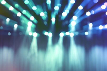 blurred lights on stage, abstract image of blue spotlight concert.