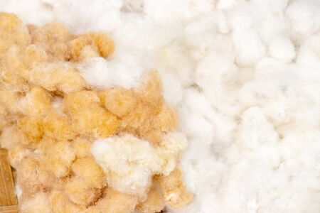 heap of brown and white cotton wool from cotton flowers in basket