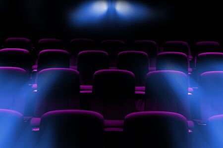 empty movie theater with purple seats with flare light rays from projector Stockfoto