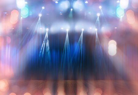 blurred multicolored bokeh lights on stage, abstract image of show or concert  lighting Banco de Imagens