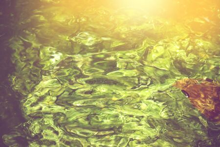 abstract water background, blurred green colour stream of water Banco de Imagens - 132125662
