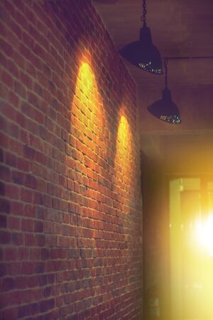 side view walkway and lamp light spot on vintage building brick wall Foto de archivo - 132125534