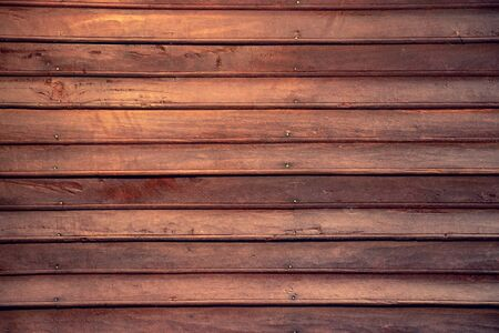 dark brown wooden plank wall background. detail of antique wooden house Banco de Imagens
