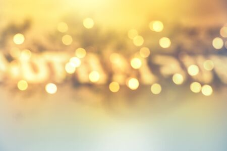 abstract blurred yellow bokeh lights in golden festive decoration background Imagens - 132125689