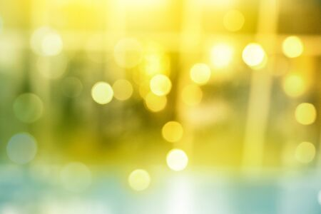abstract blurred yellow bokeh lights in golden festive decoration background Banco de Imagens