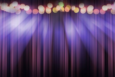 blurred theater stage with purple curtains and spotlights, abstract image of concert lighting