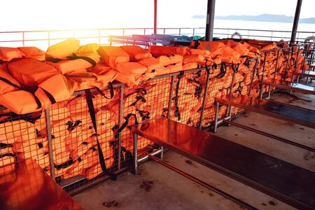 many life jacket for passengers on the deck of ferry to koh chang island, Thailand, water safety standard for tourist concept, no people
