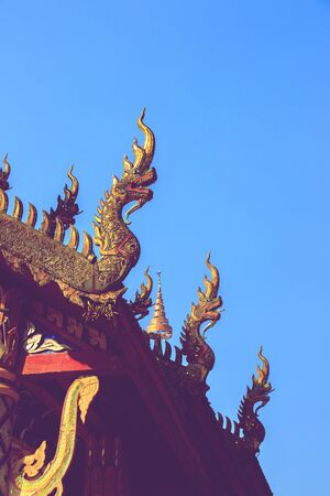 Phaya Naga or serpent on gable apex of church is Thai architectural elements of Buddhism. 版權商用圖片