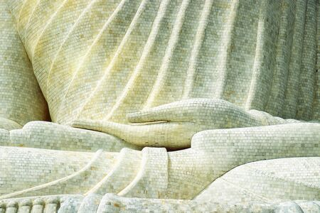 details of the marble mosaic of hand from a large Buddha statue on the hilltop in Phuket, Thailand, The attitude of subduing Mara concept