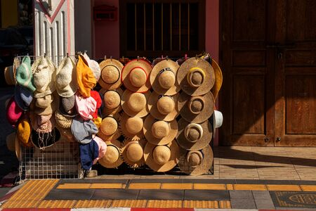 hat shop for selling on sidewalk in the touristic town at Phuket, Thailand