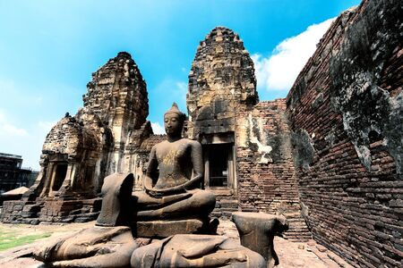 ancient ruins of buddha statue, archaeological site at Phra Prang Sam Yot in Lop Buri Province, Thailand