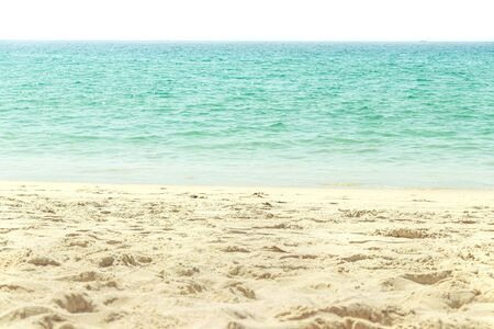 empty sand beach and tropical sea in sunlight on vacation day Standard-Bild