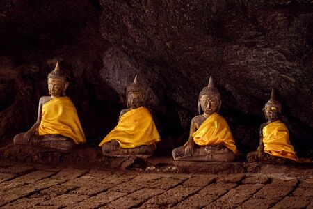 four ancient buddha statues in a cave at Chumphon Province,Thailand