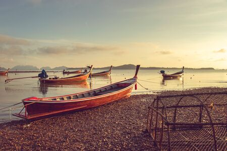 small fishing boat mooring along the seashore in the morning