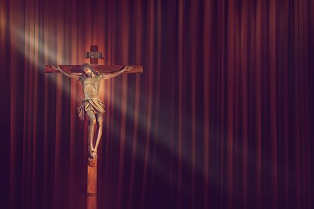 crucifix, jesus on the cross in church with ray of light on red curtain background 版權商用圖片
