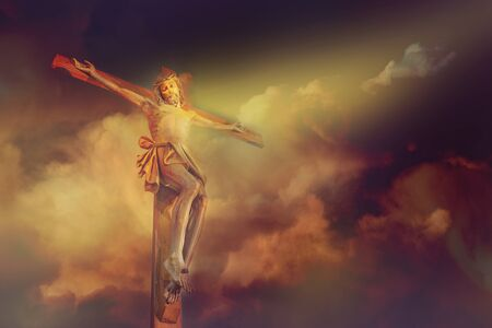 Jesus Christ crucifixion on cross with dramatic cloud over calvary sunset background