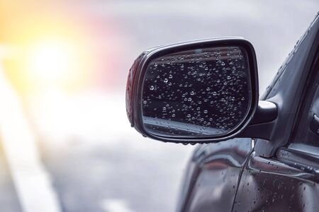 close up of water droplets on the car side mirror after rain with copy space, causing danger while using the car