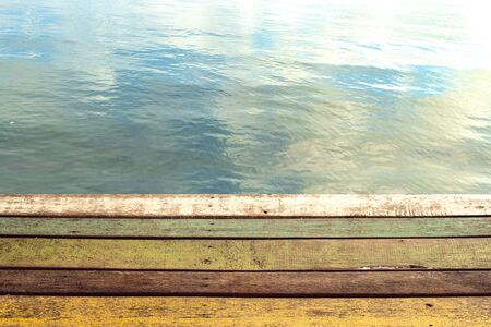 colour wood plank of pier with water of lake background