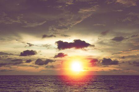 beautiful summer sunset with dark cloud at tropical beach in Thailand Standard-Bild