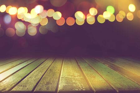 empty colour wooden table with bokeh light in dark night background