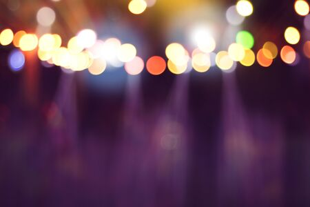 blurred lights on stage, abstract image of concert lighting, background party blur celebration concept.