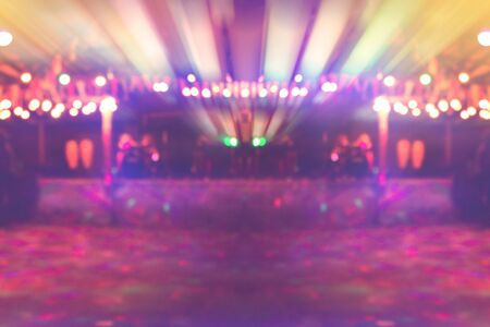 empty dancing stage in nightclub with colourful lighting background, local concert stage without people