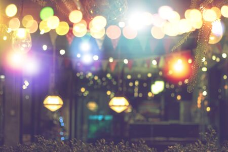 blurred bokeh night lights in restaurant, pub or bar, abstract image of night festival, christmas and happy new year party blur celebration concept background.