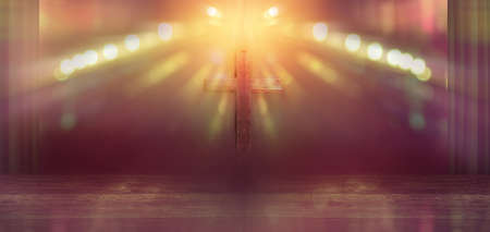 Wooden cross on stage with light rays in blurred bokeh 版權商用圖片