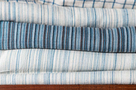 close-up of white and blue pattern cotton fabric texture on shelf in natural fabric shop 版權商用圖片