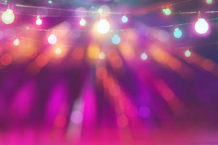 abstract blurred of colorful glittering light bulb background in festival party