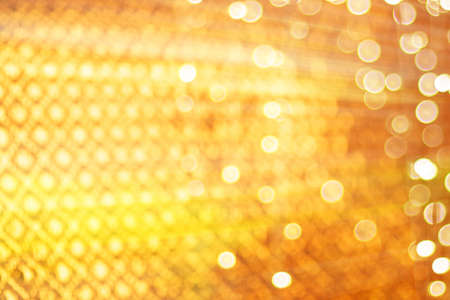 abstract defocused blurred gold glitter vintage lights background