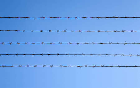 Barbed wire fence on the wall. photo