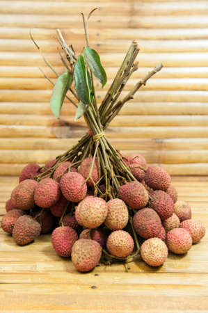 Bunch of red lychee, bamboo band. photo