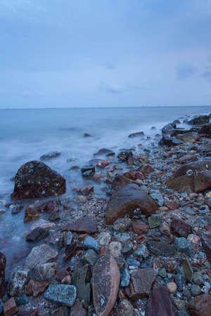 Waves hit the rocks at dawn