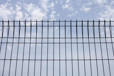 Steel fence along the road. Stock Photo - 14216975