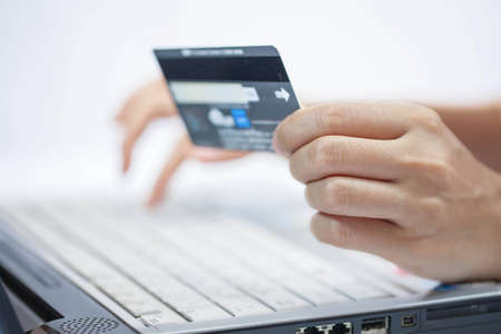 Using a credit card  Online shopping  Stock Photo