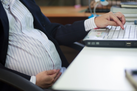 Pregnant woman sitting in office
