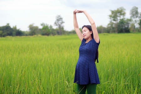 Pregnant woman on green meadow