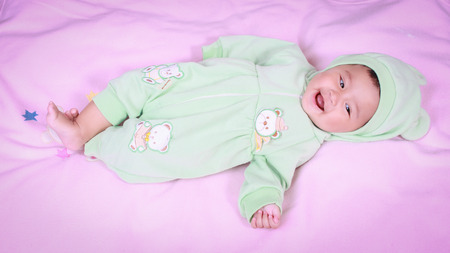 A child lying on a bed Stock Photo - 30538840