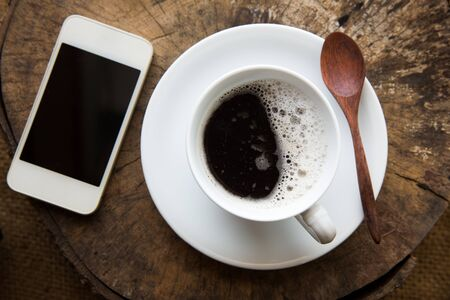 Coffee cup on a old wooden.